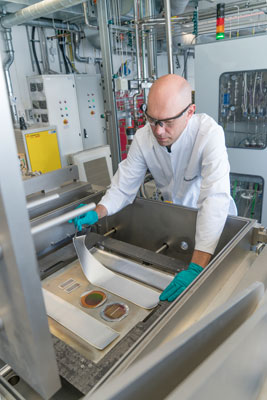 Dr. Jonas Sundqvist, group manager for thin-film technology, with prototype textile-based solar cells.
